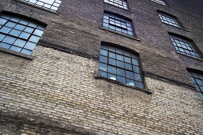 kozzi-222569-low angle view of windows of a old building-883x588