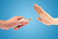 kozzi-hand reject a cigarette offer isolated on blue-1774x1183
